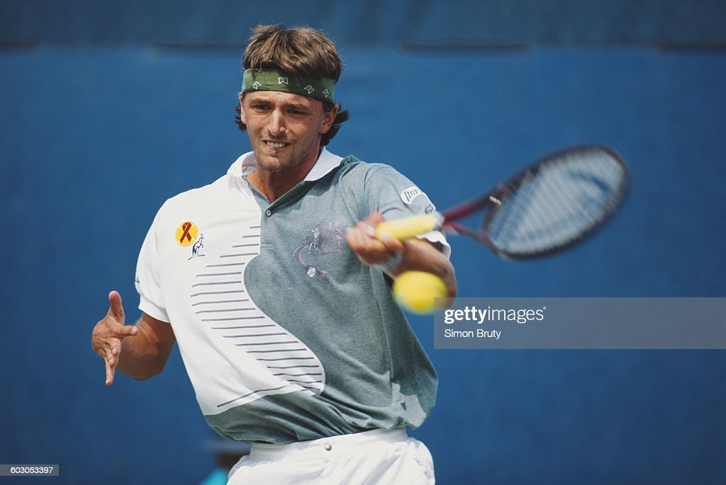 Goran Ivanisevic of Croatia returns to Marc Rosset during their Men's Singles first round match of the United States Open Tennis Championship on 31...
