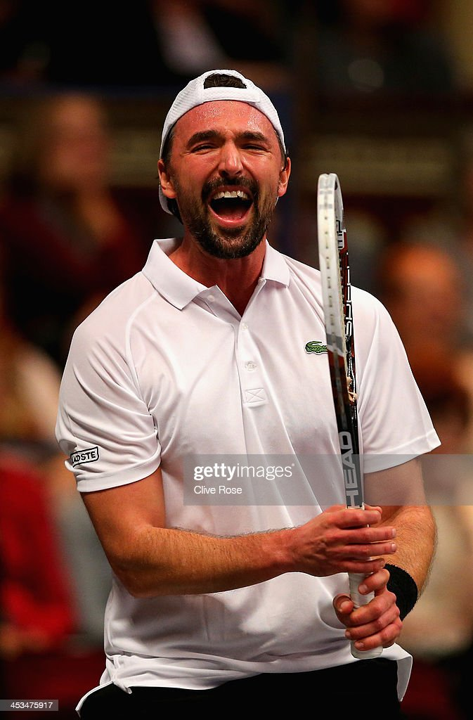 Goran Ivanisevic of Croatia scelebrates during his group match against Greg Rusedski of Great Britain on day one of the Statoil Masters Tennis at the...