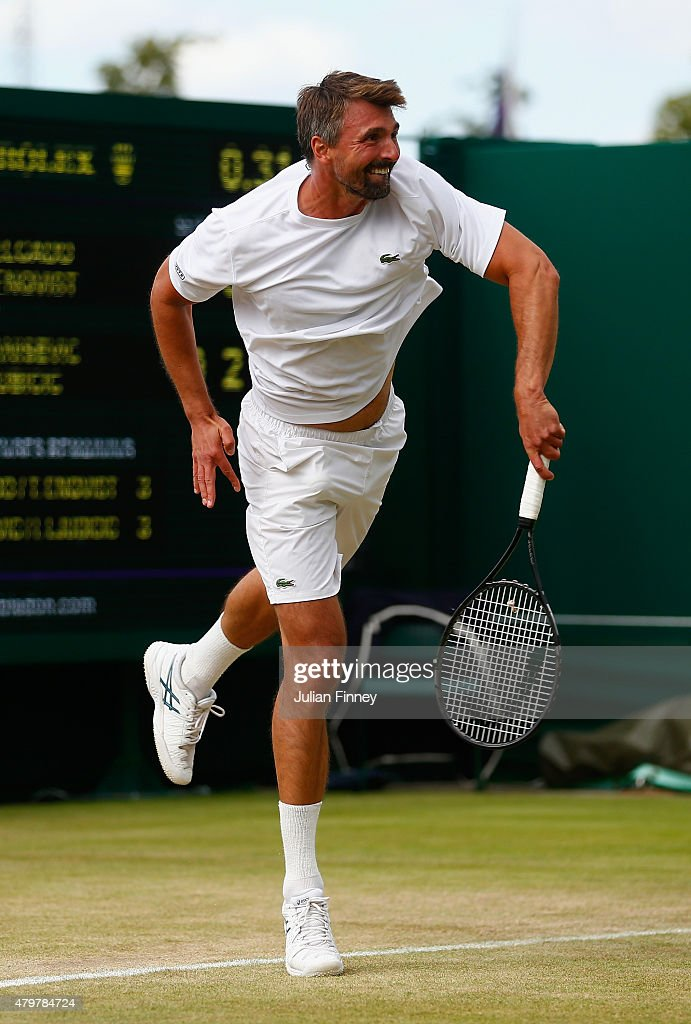Goran Ivanisevic of Croatia serves playing with partner Ivan Ljubcic of Croatia in action during the Gentlemen's Invitational Doubles against Jamie...