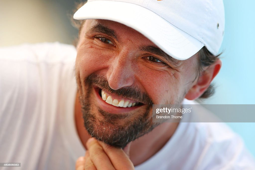 Goran Ivanisevic of Croatia shares a joke with Marin Cilic of Croatia during day one of the Sydney International at Sydney Olympic Park Tennis Centre...