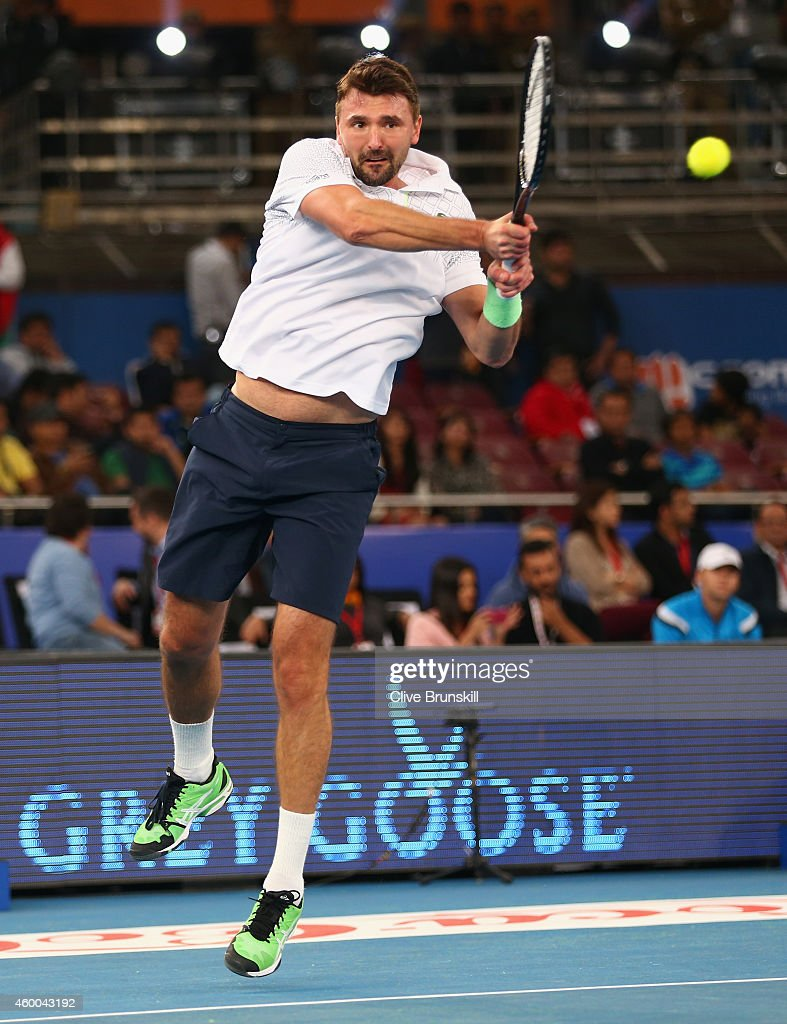 Goran Ivanisevic of the UAE Royals plays a backhand against Patrick Rafter of the Singapore Slammers during the CocaCola International Premier Tennis...
