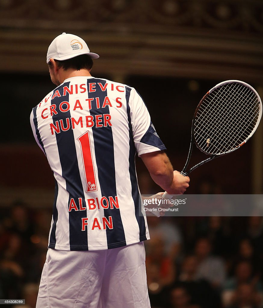 Goran Ivanisevic wears his West Brom shirt which reads 'Ivanisevic Croatia's Number 1 Albion Fan' during the doubles match between Mansour Bahrami...