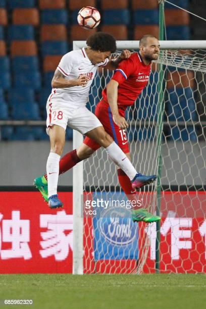Goran Milovic of Chongqing Lifan and Axel Witsel of Tianjin Quanjian compete for the ball during the 10th round match of 2017 Chinese Football...