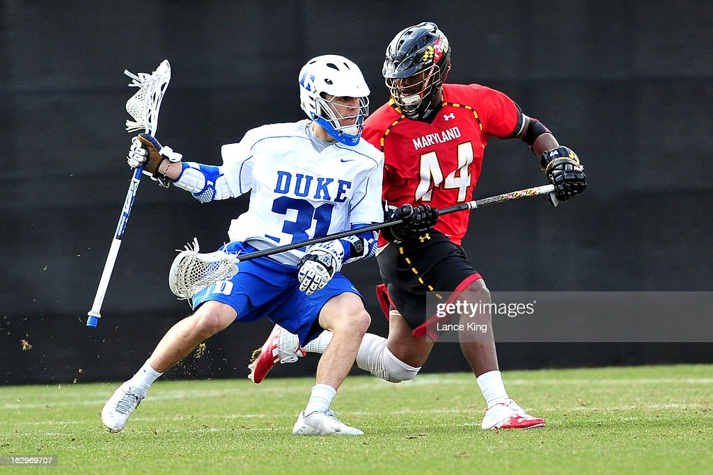 Goran Murray #44 of the Maryland Terrapins checks Jordan Wolf #31 of the Duke Blue Devils at Koskinen Stadium on March 2, 2013 in Durham, North Carolina. Maryland defeated Duke 16-7.