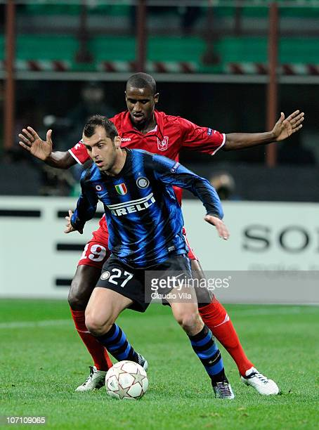 Goran Pandev of FC Internazionale Milano and Douglas of FC Twente compete for the ball during the UEFA Champions League Group A match between FC...