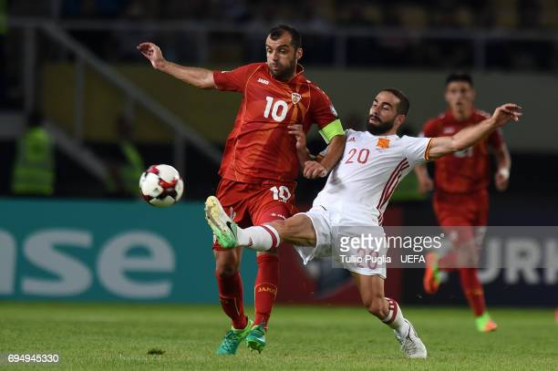 Goran Pandev of FYR Macedonia and Dani Carvajal of Spain compete for the ball during the FIFA 2018 World Cup Qualifier between FYR Macedonia and...