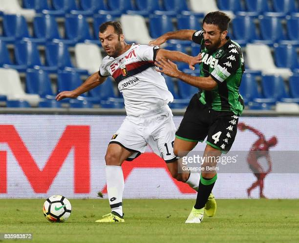 Goran Pandev of Genoa CFC and Francesco Magnanelli of US Sassuolo in action during the Serie A match between US Sassuolo and Genoa CFC at Mapei...