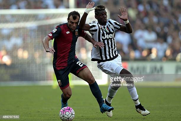 Goran Pandev of Genoa CFC battles for the ball with Paul Pogba of Juventus FC during the Serie A match between Genoa CFC and Juventus FC at Stadio...