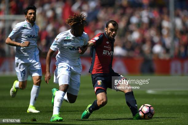 Goran Pandev of Genoa CFC competes with Samuel Bastien of AC ChievoVerona during the Serie A match between Genoa CFC and AC ChievoVerona at Stadio...