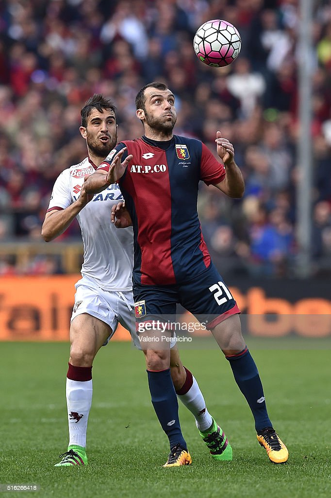 <a gi-track='captionPersonalityLinkClicked' href=/galleries/search?phrase=Goran+Pandev&family=editorial&specificpeople=800427 ng-click='$event.stopPropagation()'>Goran Pandev</a> (R) of Genoa CFC is challenged by Nikola Maksimovic of Torino FC during the Serie A match between Genoa CFC and Torino FC at Stadio Luigi Ferraris on March 13, 2016 in Genoa, Italy.