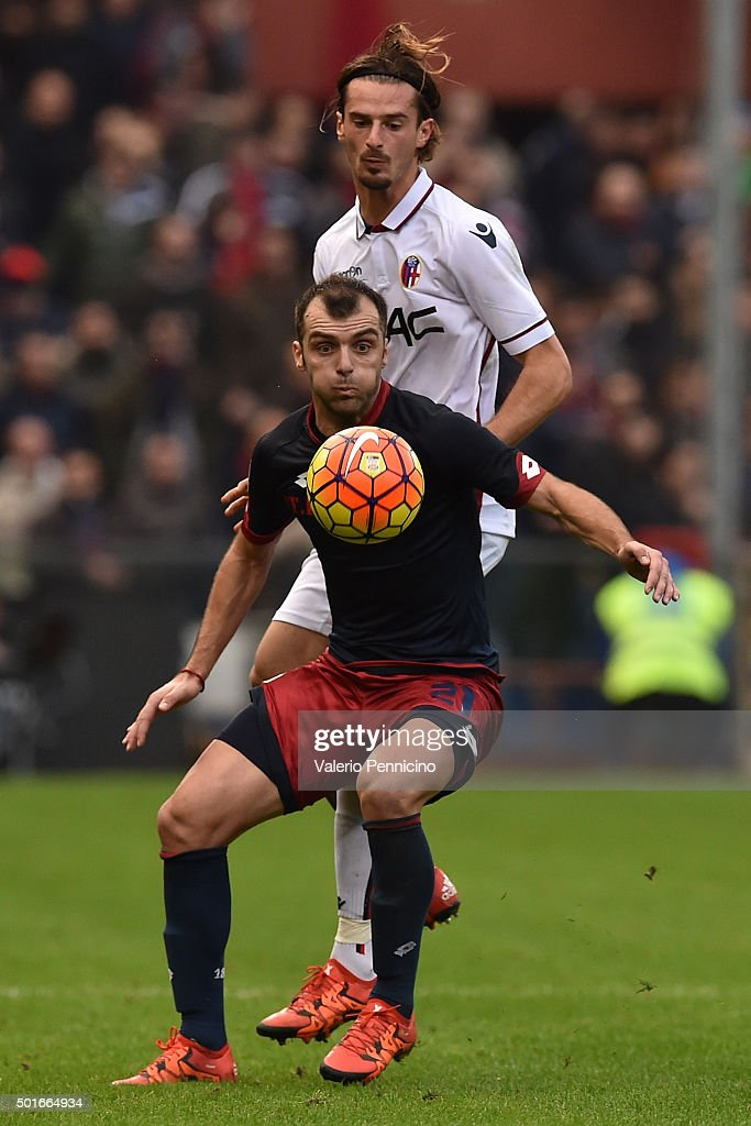 <a gi-track='captionPersonalityLinkClicked' href=/galleries/search?phrase=Goran+Pandev&family=editorial&specificpeople=800427 ng-click='$event.stopPropagation()'>Goran Pandev</a> (L) of Genoa CFC is tackled by MariosÊOikonomou of Bologna FC during the Serie A match betweeen Genoa CFC v Bologna FC at Stadio Luigi Ferraris on December 12, 2015 in Genoa, Italy.
