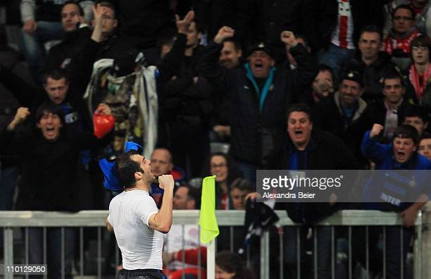 Goran Pandev of Inter Milan celebrates his goal with fans during the UEFA Champions League round of 16 second leg match between FC Bayern Muenchen...