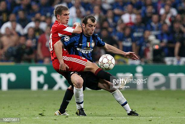 Goran Pandev of Inter Milan challenges Philipp Lahm of Bayern Muenchen during the UEFA Champions League Final match between FC Bayern Muenchen and...