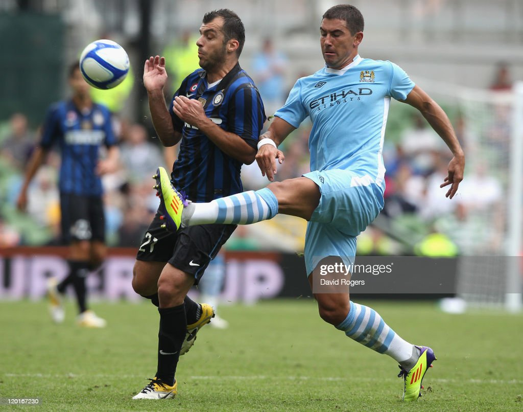 <a gi-track='captionPersonalityLinkClicked' href=/galleries/search?phrase=Goran+Pandev&family=editorial&specificpeople=800427 ng-click='$event.stopPropagation()'>Goran Pandev</a>(L) of Inter Milan is challenged by Aleksander Kolarov during the Dublin Super Cup match between Inter Milan and Manchester City at the Aviva Stadium on July 31, 2011 in Dublin, Ireland.