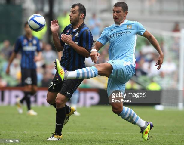 Goran Pandev of Inter Milan is challenged by Aleksander Kolarov during the Dublin Super Cup match between Inter Milan and Manchester City at the...