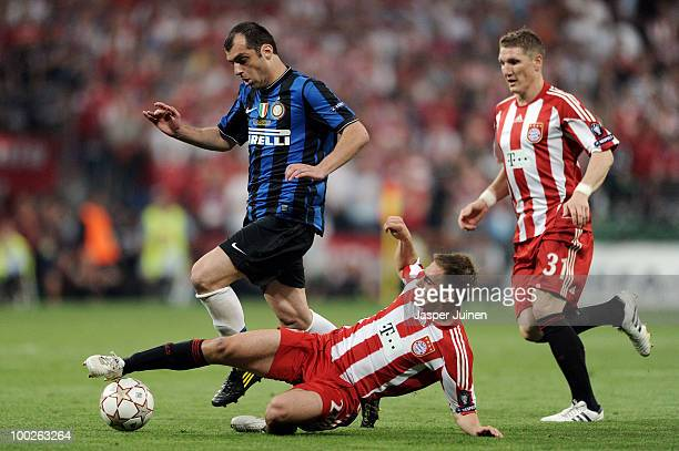 Goran Pandev of Inter Milan is challenged by Philipp Lahm and Bastian Schweinsteiger of Bayern Muenchen during the UEFA Champions League Final match...