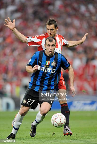 Goran Pandev of Inter Milan moves away from Miroslav Klose of Bayern Munich during the UEFA Champions League Final match between Bayern Munich and...