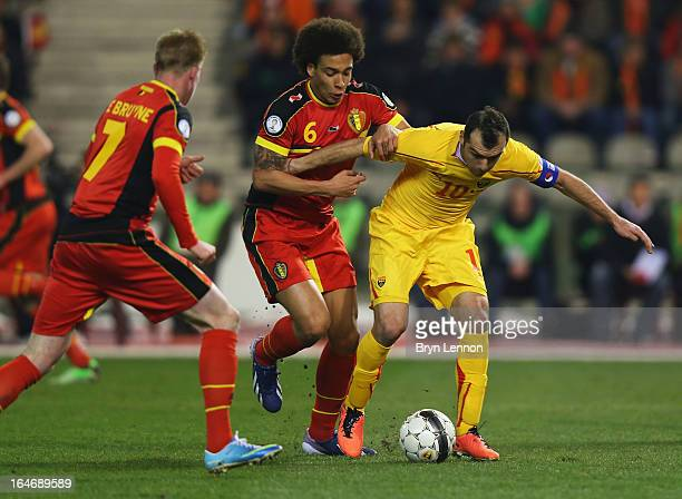 Goran Pandev of Macedonia holds off Axel Witsel of Belgium during the FIFA 2014 World Cup Qualifier Group A match between Belgium and Macedonia at...