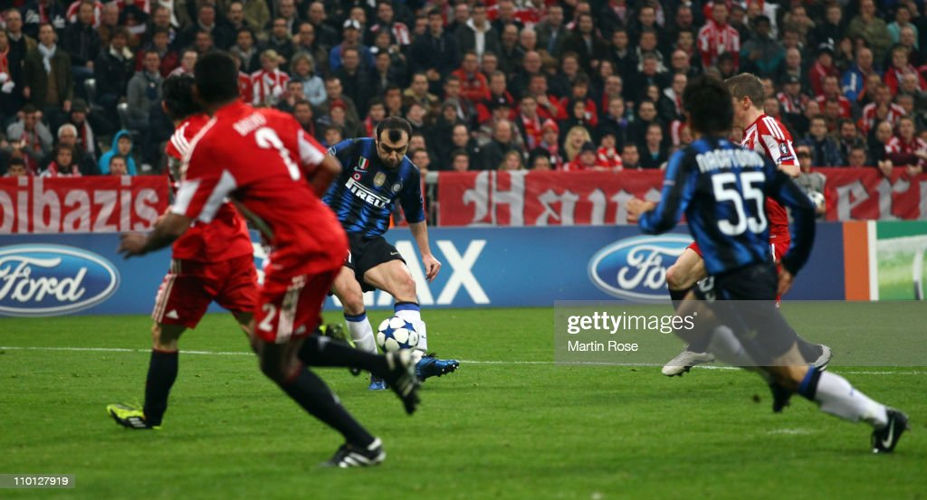 <a gi-track='captionPersonalityLinkClicked' href=/galleries/search?phrase=Goran+Pandev&family=editorial&specificpeople=800427 ng-click='$event.stopPropagation()'>Goran Pandev</a> (C) of Milan scores his team's 3rd goal during the UEFA Champions League round of 16 second leg match between FC Bayern Muenchen and Inter Milan at Allianz Arena on March 15, 2011 in Munich, Germany.
