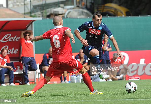 Goran Pandev of Napoli competes with Emanuele Padella of Grosseto during the preseason friendly match between SSC Napoli and US Grosseto on July 23...