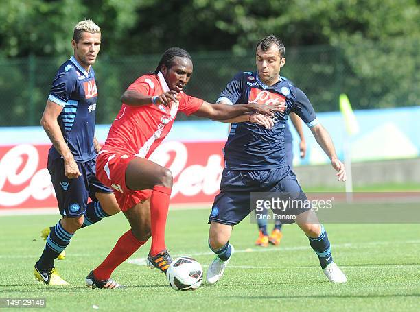 Goran Pandev of Napoli competes with Kenneth Obodo of Grosseto during the preseason friendly match between SSC Napoli and US Grosseto on July 23 2012...