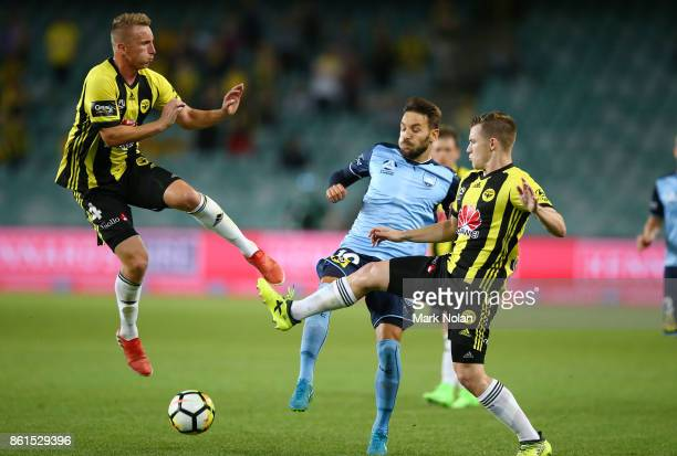 Goran Paracki and Scott Galloway of Wellington contest possesion with Milos Ninkovic of Sydney during the round two ALeague match between Sydney FC...