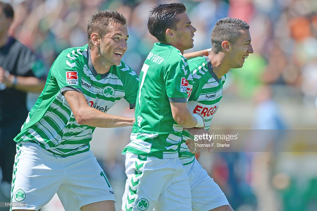 Goran Sukalo, Zoltan Stieber and Nikola Djurdjic celebrate their teams second goal during the Second Bundesliga match between Greuther Fuerth and Arminia Bielefeld at the Trolli Arena on July 21, 2013 in Fuerth, Germany.