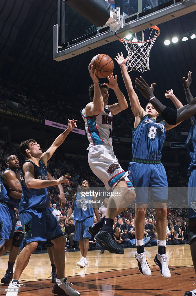 Gordan Giricek #10 of the Memphis Grizzlies looks to shoots under pressure during the NBA game against the Minnesota Timberwolves at The Pyramid on November 15, 2002 in Memphis, Tennessee. The Timberwolves won 99-95.