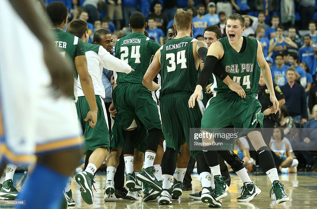 Gordan Zach #44 and Brian Bennett #34 of the Cal Poly Mustangs celebrate with their team after the game against the UCLA Bruins at Pauley Pavilion on November 25, 2012 in Los Angeles, California. Cal Poly won 70-68.