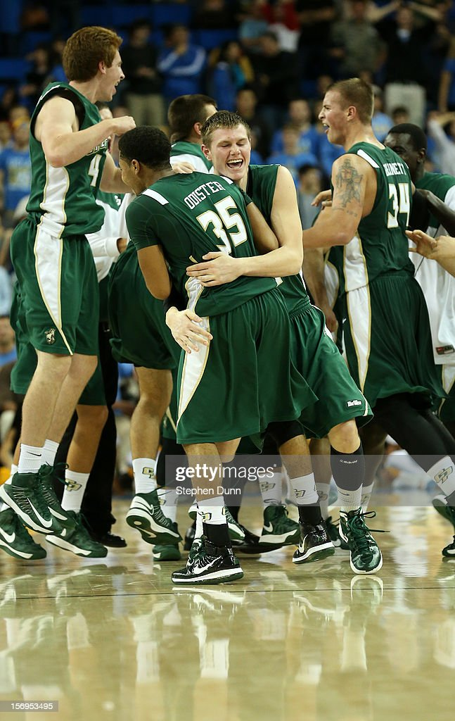 Gordan Zach #44 of the Cal Poly Mustangs hugs Kyle Odister #35 as their team celebrates after the game against the UCLA Bruins at Pauley Pavilion on November 25, 2012 in Los Angeles, California. Cal Poly won 70-68.