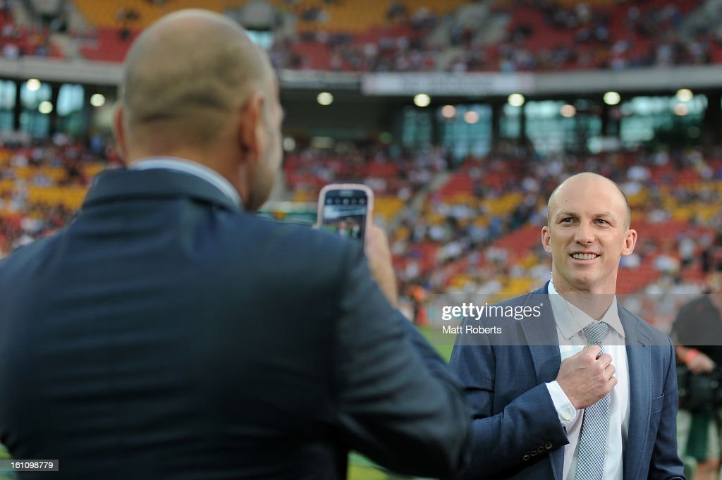 Gorden Tallis (L) takes a photo of Darren lockyer on a fans phone during the NRL All Stars Game between the Indigenous All Stars and the NRL All Stars at Suncorp Stadium on February 9, 2013 in Brisbane, Australia.