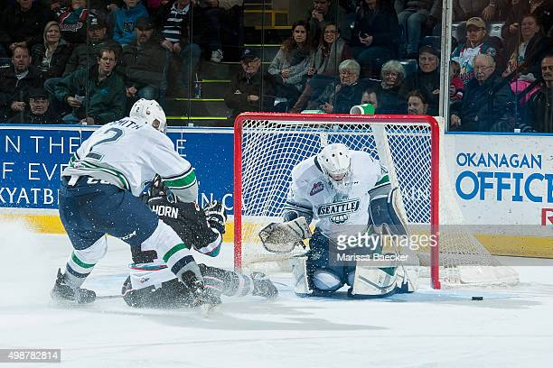 Gordie Ballhorn of Kelowna Rockets is checked to the ice by Jerret Smith as he tries to score a goal on Logan Flodell of Seattle Thunderbirds on...