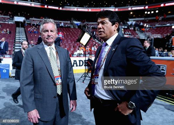 Gordie Clark Director of Player Personnel for the New York Rangers and Ted Nolan Head Coach of the Buffalo Sabres speak before the start of the first...