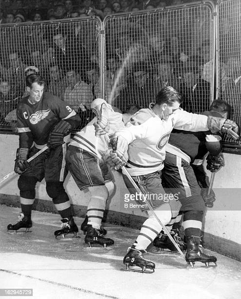 Gordie Howe and Red Kelly of the Detroit Red Wings battle with Dickie Moore and Maurice Richard of the Montreal Canadiens circa 1955 at the Detroit...