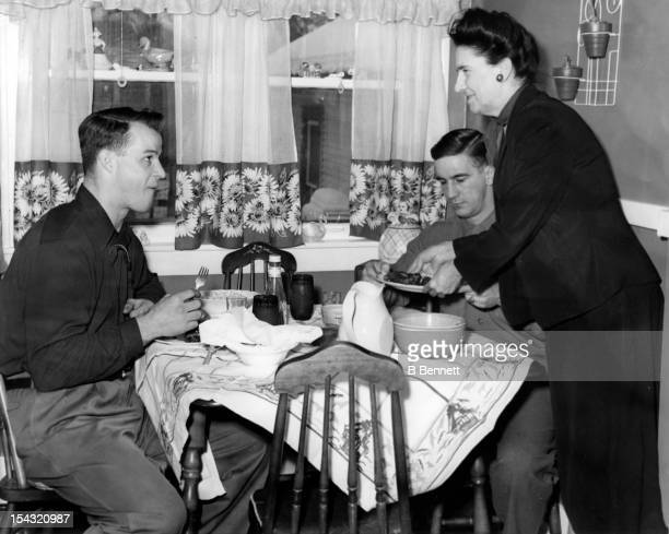 Gordie Howe and Ted Lindsay of the Detroit Red Wings are served breakfast by Ted's mother Maude Lindsay as they eat before getting ready for their...