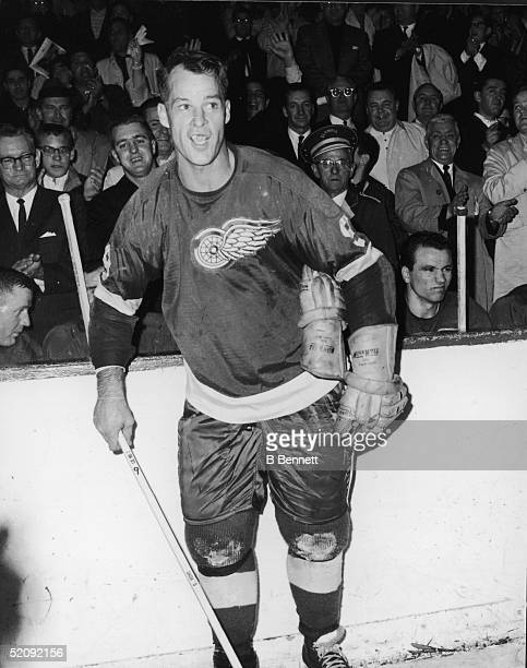 Gordie Howe of the Detroit Red Wings celebrates after his 545th goal and breaking the NHL goal scoring record during a game against the Montreal...