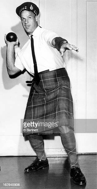 Gordie Howe of the Detroit Red Wings dressed in Scottish attire for the 78th Caledonian Games poses in the shot put position on August 3 1964 in...