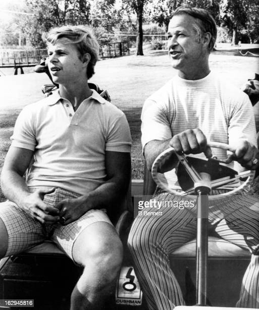 Gordie Howe of the Detroit Red Wings drives a golf cart with his son Mark Howe during a round of golf before he annouces his retirement from hockey...