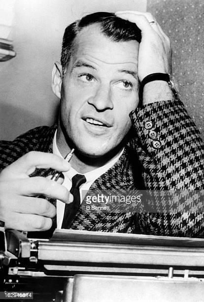 Gordie Howe of the Detroit Red Wings looks on from behind a typewriter after appearing on TV as a mystery guest on May 31 1963 in Ottawa Ontario...