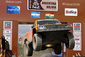 TOPSHOT Gordini's US driver Robby Gordon and codriver Kellon Walch jump on the podium at the end of the Stage 5 of the Dakar Rally 2016 between Jujuy...