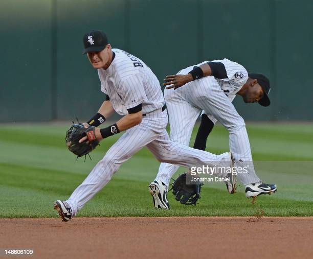Gordon Beckham and Alexei Ramirez of the Chicago White Sox both move to field the ball against the Chicago Cubs at US Cellular Field on June 20 2012...