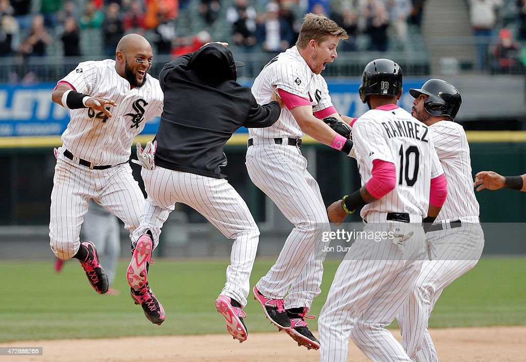 Gordon Beckham #15 of the Chicago White Sox and the team celebrate after he hit the game winning RBI against the Cincinnati Reds during the ninth inning on May 10, 2015 at U.S. Cellular Field in Chicago, Illinois.
