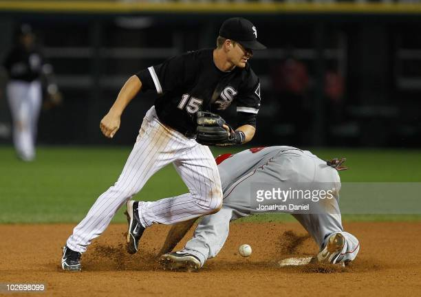 Gordon Beckham of the Chicago White Sox can't grab the ball as Howard Kendrick of the Los Angeles Angels of Anaheim slides into 2nd base at US...