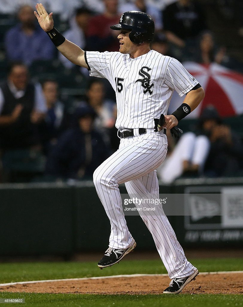 Gordon Beckham #15 of the Chicago White Sox celebrates scoring a run in the 4th inning against the Los Angeles Angels of Anaheim at U.S. Cellular Field on July 2, 2014 in Chicago, Illinois.