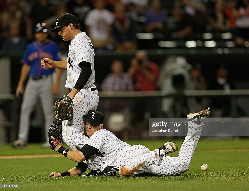 <a gi-track='captionPersonalityLinkClicked' href=/galleries/search?phrase=Gordon+Beckham&family=editorial&specificpeople=5411079 ng-click='$event.stopPropagation()'>Gordon Beckham</a> #15 of the Chicago White Sox (R) collides with <a gi-track='captionPersonalityLinkClicked' href=/galleries/search?phrase=Conor+Gillaspie&family=editorial&specificpeople=5115369 ng-click='$event.stopPropagation()'>Conor Gillaspie</a> #12 as they try to catch a infield pop fly by Daniel Murphy of the New York Mets in the top of the 9th inning at U.S. Cellular Field on June 25, 2013 in Chicago, Illinois. The White Sox defeated the Mets 5-4.
