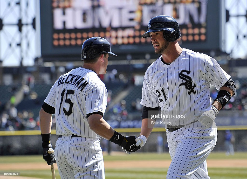 Gordon Beckham #15 of the Chicago White Sox congratulates teammate Tyler Flowers #21 after Flowers hit a solo home run during the third inning against the Kansas City Royals on April 3, 2012 at U.S. Cellular Field in Chicago, Illinois.