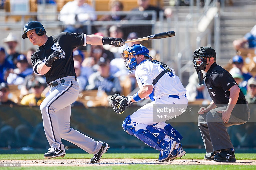 <a gi-track='captionPersonalityLinkClicked' href=/galleries/search?phrase=Gordon+Beckham&family=editorial&specificpeople=5411079 ng-click='$event.stopPropagation()'>Gordon Beckham</a> #15 of the Chicago White Sox doubles in a run during a spring training game against the Los Angeles Dodgers at Camelback Ranch on February 23, 2013 in Glendale, Arizona.