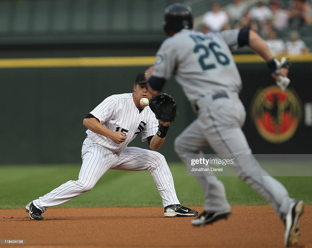 <a gi-track='captionPersonalityLinkClicked' href=/galleries/search?phrase=Gordon+Beckham&family=editorial&specificpeople=5411079 ng-click='$event.stopPropagation()'>Gordon Beckham</a> #15 of the Chicago White Sox fields the ball as <a gi-track='captionPersonalityLinkClicked' href=/galleries/search?phrase=Brendan+Ryan&family=editorial&specificpeople=835643 ng-click='$event.stopPropagation()'>Brendan Ryan</a> #26 of the Seattle Mariners runs past at U.S. Cellular Field on June 8, 2011 in Chicago, Illinois. The Mariners defeated the White Sox 7-4 in 10 innings.