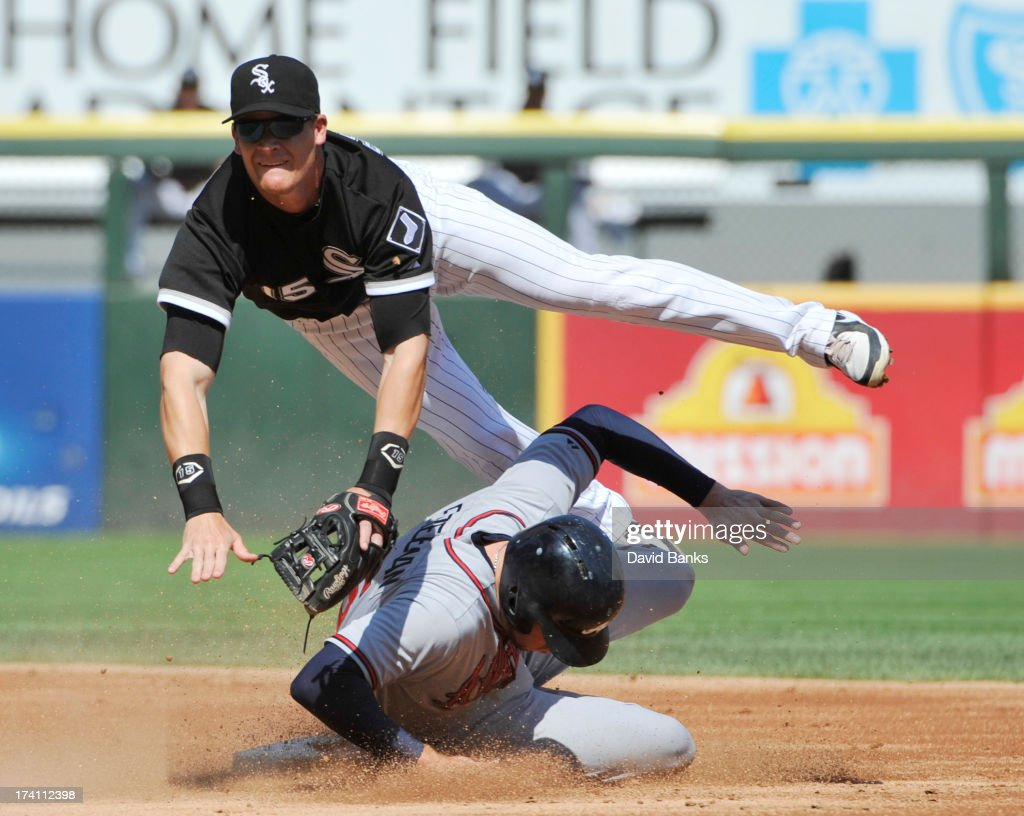 Gordon Beckham #15 of the Chicago White Sox forces out Freddie Freeman #5 of the Atlanta Braves during the second inning on July 20, 2013 at U.S. Cellular Field in Chicago, Illinois.