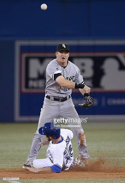 Gordon Beckham of the Chicago White Sox forces out the lead runner at second base but cannot turn the double play in the ninth inning during MLB game...